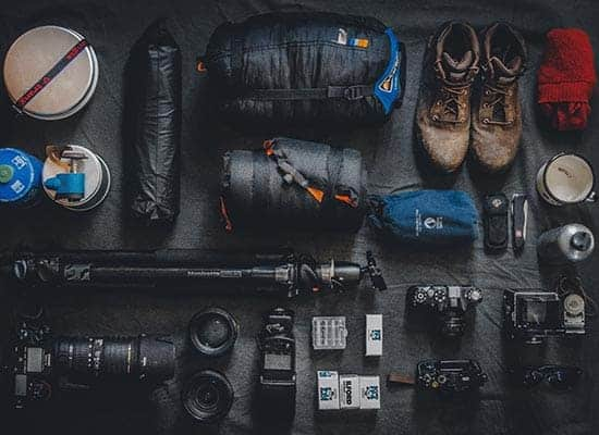 gear and hiking resources laid out to prepare for a hiking trip