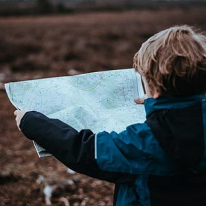 Hiking Resources - young kid holding a map