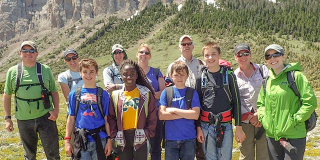 Get involved on National Trails Day and hit the trail. This diverse group poses for a picture during a group hike in Montana