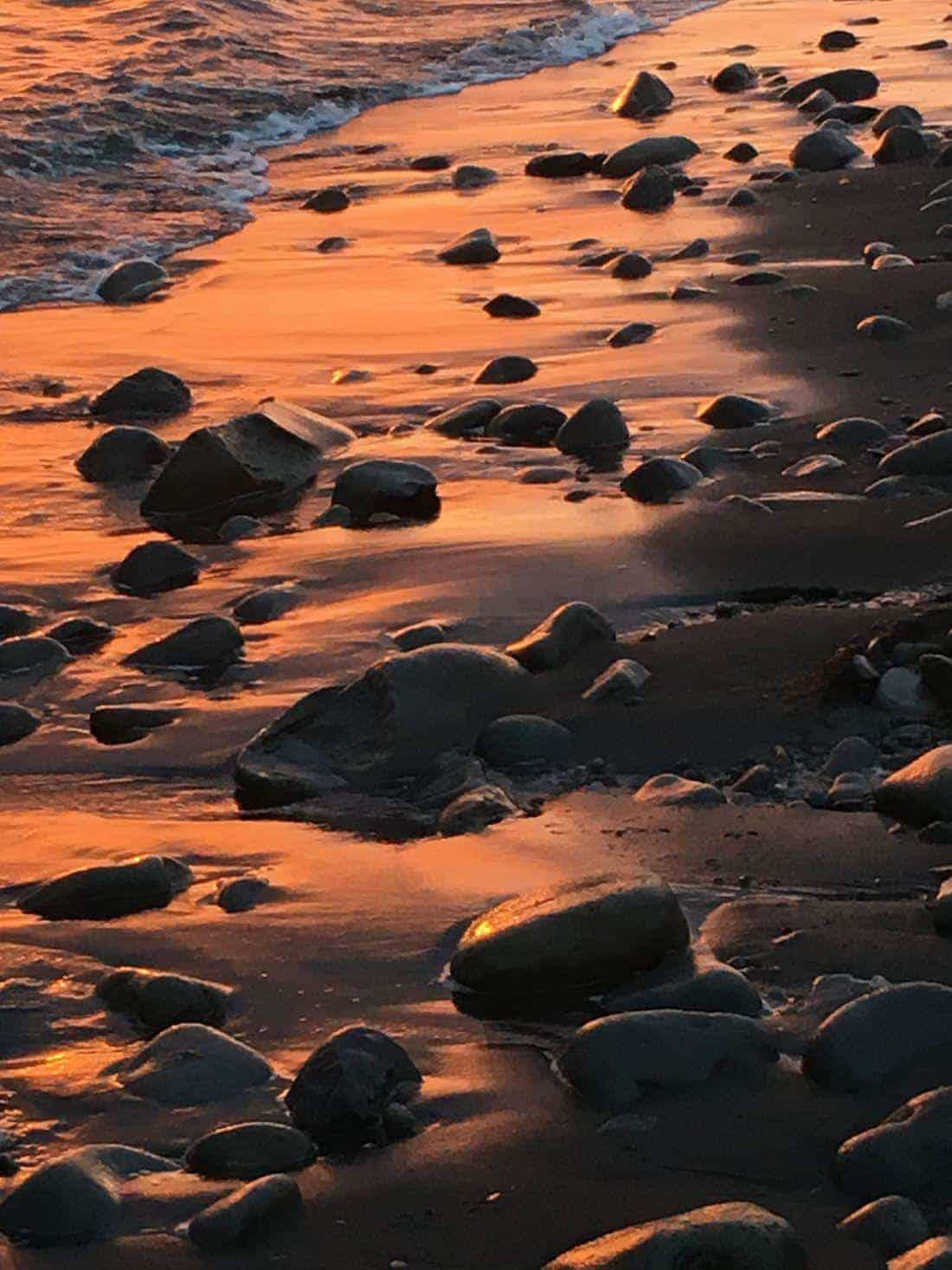 Iceland seashore hiking at sunset