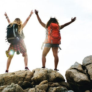Hiker celebrate on rock outcrop