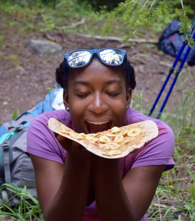 hiker ready to eat peanut butter and banana tortilla.