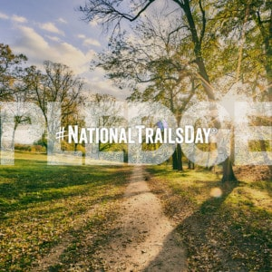 National Trails Day Pledge graphic over sunny morning trail