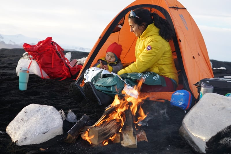 Mother and Child enjoy the warmth of a campfire