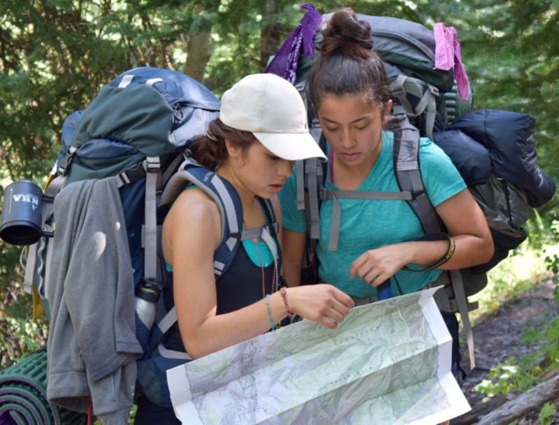 Two backpackers review their map