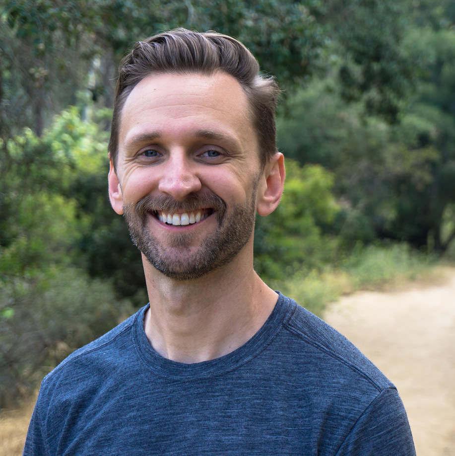 Casey Schreiner standing on a gravel path